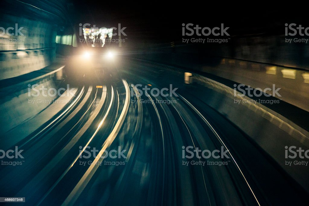 Dubai Metro train running fast in the tunnel stock photo