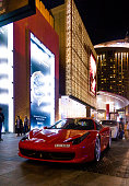 Dubai, United Arab Emirates - March 25, 2015: The road outside The Dubai Mall in Dubai, United Arab Emirates. Some luxury sport cars parking on the road. The Dubai Mall is the world's largest shopping mall based on total area and fourteenth largest by gross leasable area