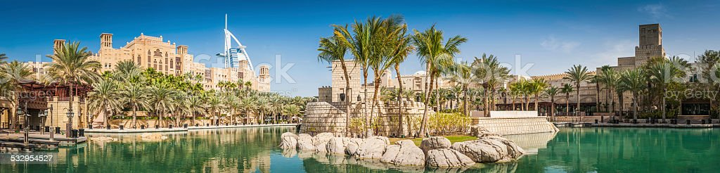 Dubai palm trees lagoon hotels and restaurants Burj panorama UAE stock photo