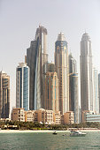 Dubai, UAE - March 28, 2015: Incredible panorama of Dubai during the day. There is also the view of Jumeirah beach..