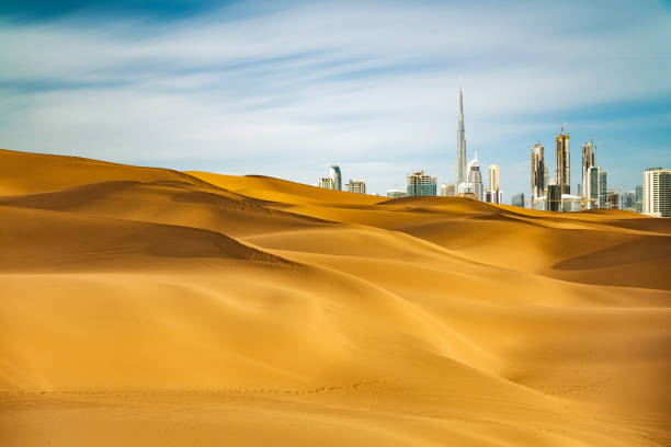 Dubai scenery Looking along desert towards the business district. burj khalifa stock pictures, royalty-free photos & images