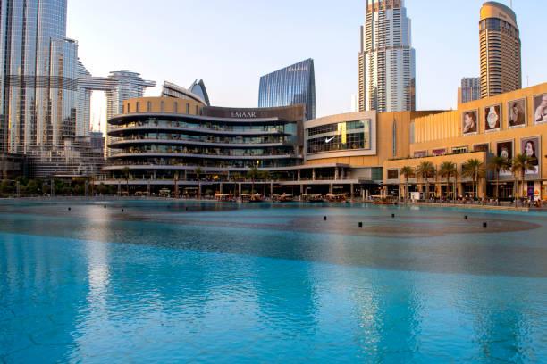Dubai shopping mall exterior with fountains pool. stock photo
