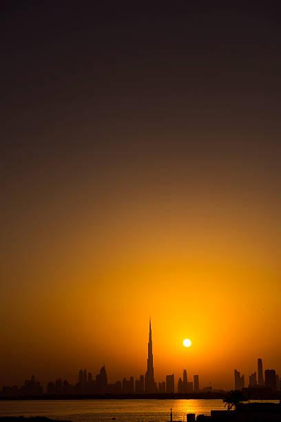 dubai silhouette at sunset stock photo