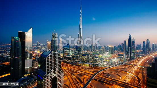 istock Dubai sky line with traffic junction and Burj Khalifa 469692894