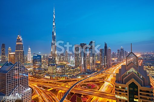 istock Dubai sky line with traffic junction at dusk 1152354178