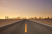 Dubai skyline and highway at sunset, United Arab Emirates.