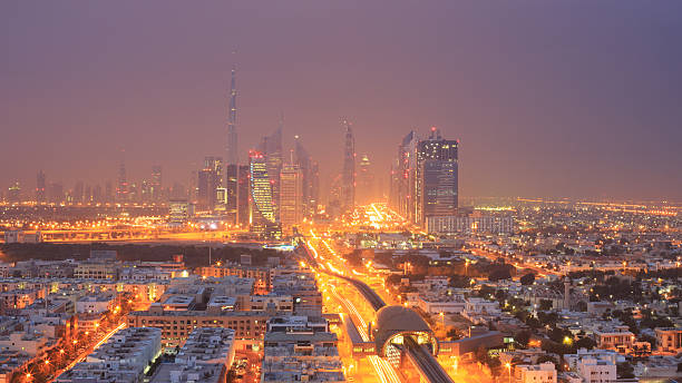 dubai skyline at dawn - sheikh zayed road stock-fotos und bilder