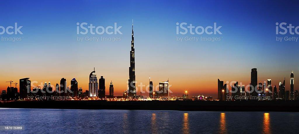 Dubai skyline at dusk seen from the Gulf Coast stock photo