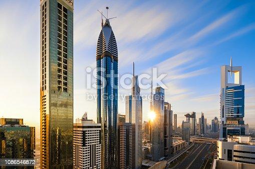 512697874 istock photo Dubai skyline at sunrise 1086546872