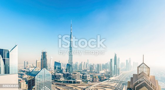 The new Dubai down town district with the Burj Khalifa rising above the ultra modern skyline.