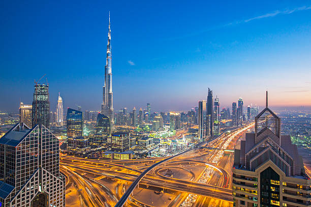 Dubai skyline High up view of Dubai and its roads at dusk. burj khalifa stock pictures, royalty-free photos & images