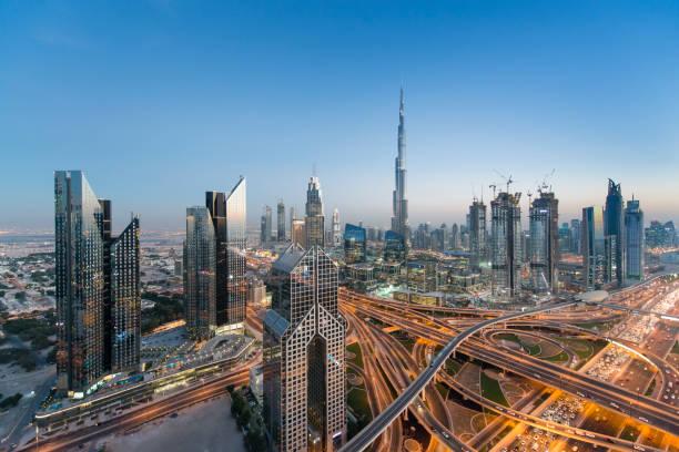 Dubai skyline Dubai skyline seen during the evening. dubai stock pictures, royalty-free photos & images