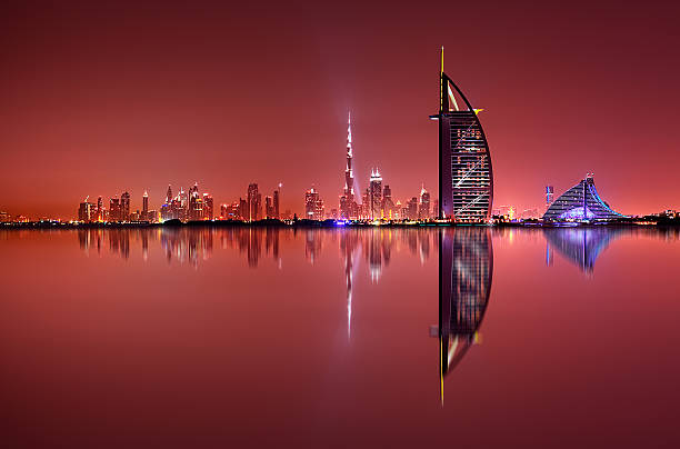 Dubai skyline reflection, Dubai, United Arab Emirates Dubai skyline reflection at amazing night, Dubai, United Arab Emirates dubai stock pictures, royalty-free photos & images
