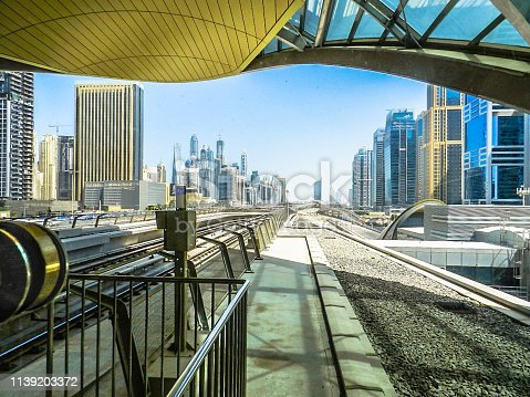 Beautiful Dubai panoramic skyline view from Metro station, part of the station roof frames the perspective of this city landscape on September 28, 2013