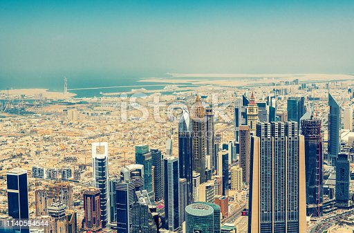 Dubai skyscrapers skyline from above with a view of the desert and the Persian Gulf