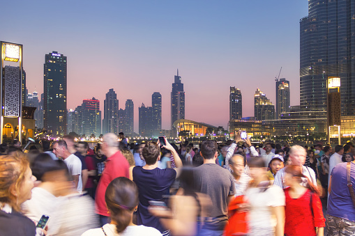 DUBAI, UNITED ARAB EMIRATES - 28 Ott, 2016: Outside the Dubai Mall. People photographing the Burj Khalifa, the highest skyscraper in the world, and its fountain.