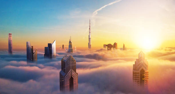 Dubai sunset view of downtown covered with clouds stock photo