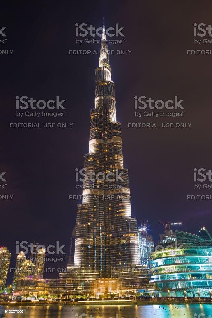 Dubai - The nightly Burj Khalifa and the fountain. stock photo