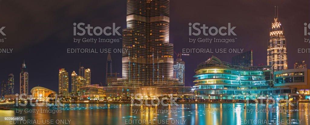 Dubai - The nightly panorama of funtain in front of Burj Khalifa. stock photo