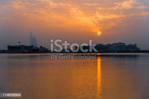 Dubai The Palm Jumeirah - Homes at dawn with Hotel Burj al Arab