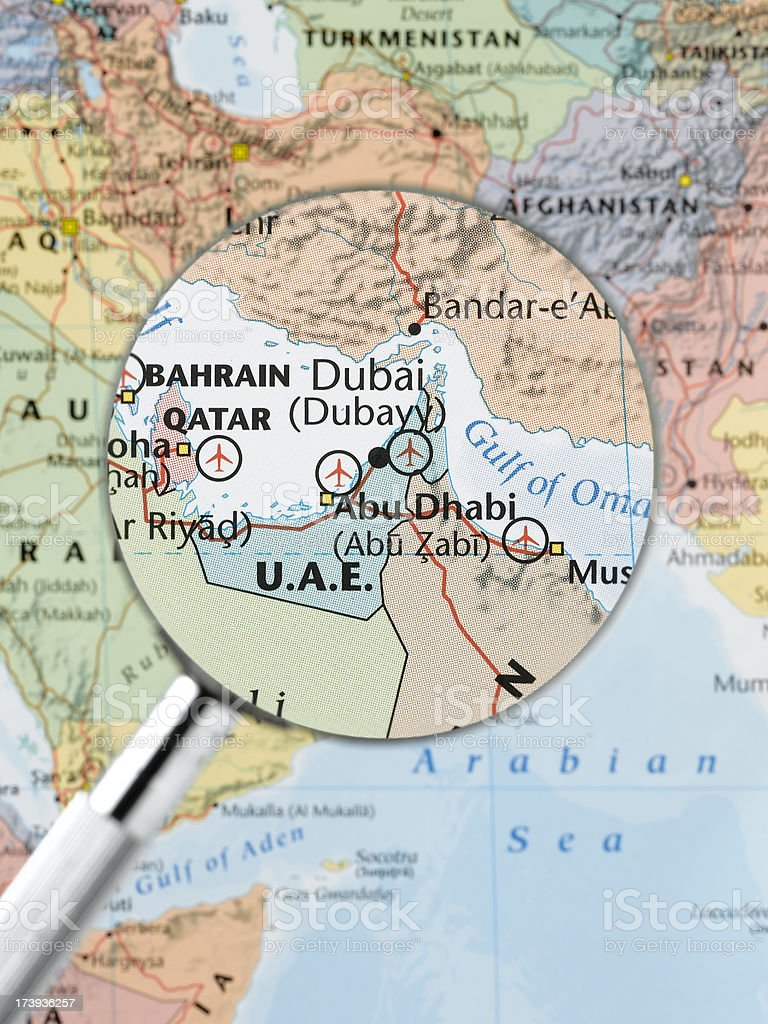 Dubai thru magnifying glass stock photo more pictures of dubai thru magnifying glass royalty free stock photo gumiabroncs Image collections