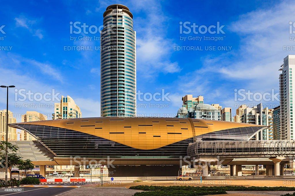 Dubai, UAE: Jumeirah Lake Towers Metro Station in morning sunlight. stock photo