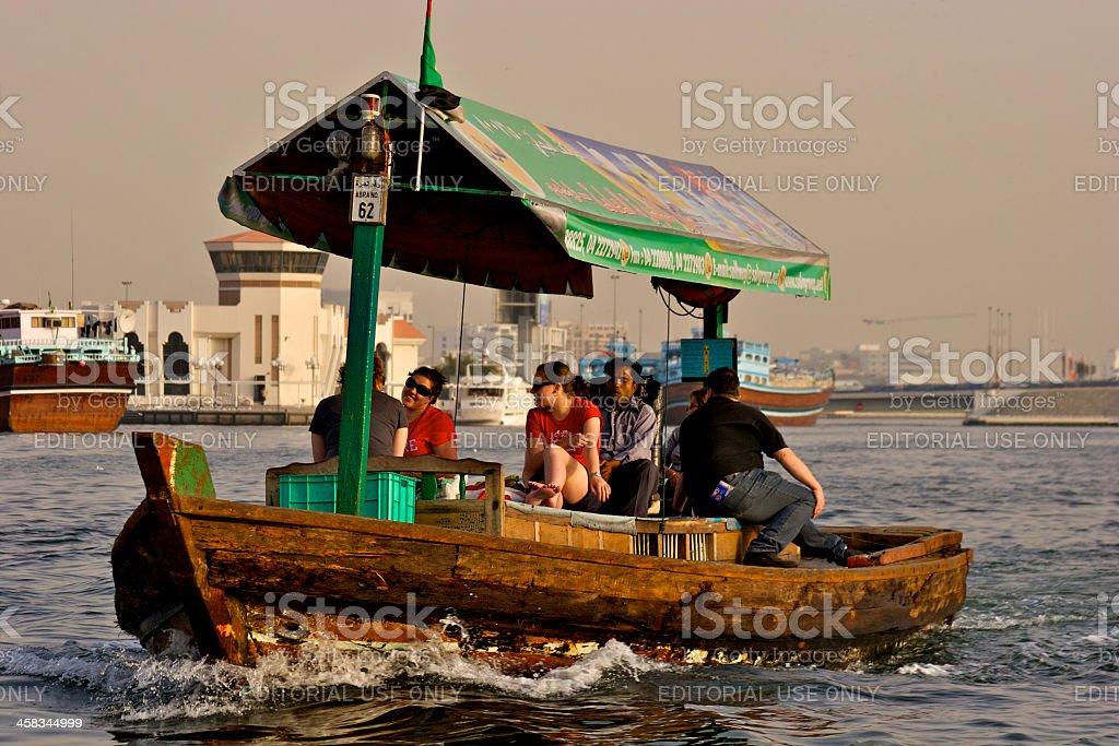 Dubai, UAE - Tourists on an Abra royalty-free stock photo