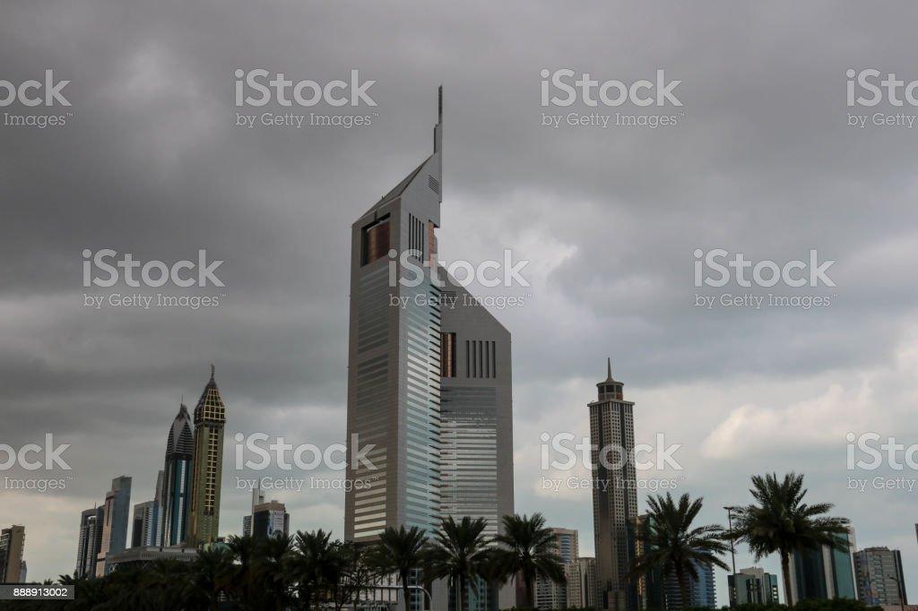 Dubai, United Arab Emirates - 05/05/2017 - Beautiful view of Skyscrapers Emirates Towers under Cloudy sky in Dubai stock photo