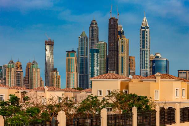 Dubai, United Arab Emirates - Landside View Of Dubai Marina Skyscrapers; Some Under Construction. Foreground: Meadows Villas. stock photo