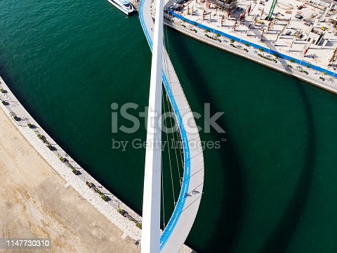 Dubai water canal tolerance bridge over the creek aerial view