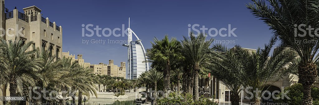 Dubai wind towers palm trees Burj Al Arab stock photo