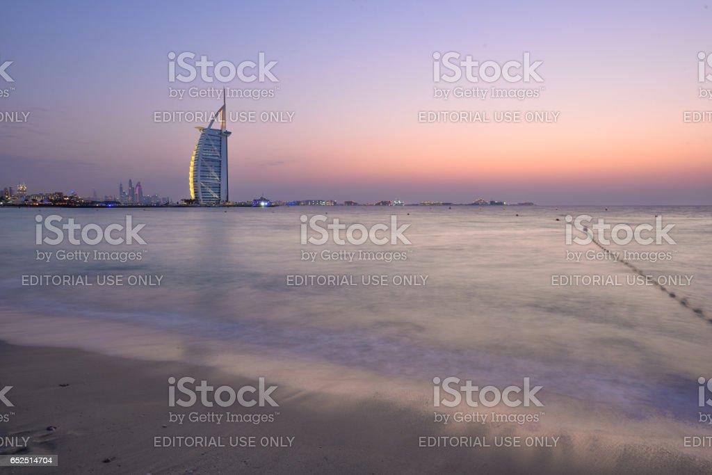 Dubai's beach with Burj Al Arab hotel at sunset stock photo