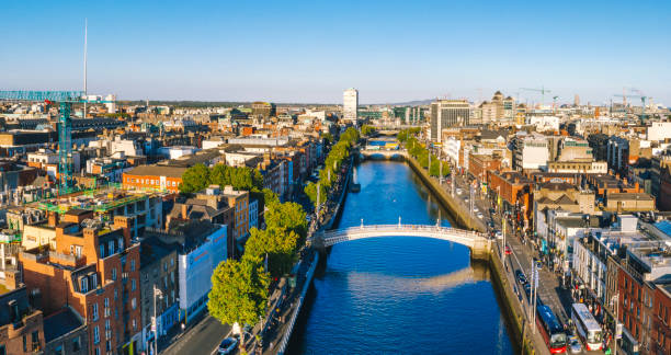 Dublin aerial with Ha'penny bridge and Liffey river during sunset in Dublin, Ireland stock photo