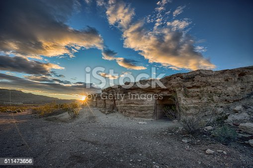 Shoshone, California, USA- January 8, 2016: Dugged up quarters for miners of the early 1900's taken during sunrise.