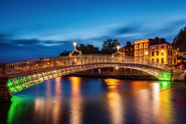 Dublin Ha'penny Bridge by Night Ireland stock photo