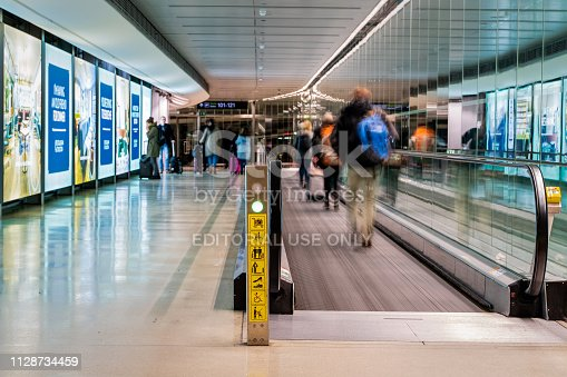 istock Dublin, Ireland - January 2019 Dublin airport, people rushing for their flights, long corridor with moving walkway, motion blur 1128734459