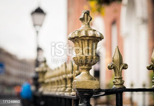 Close-up of traditional painted iron railing decorations on the street in central Dublin, Ireland.