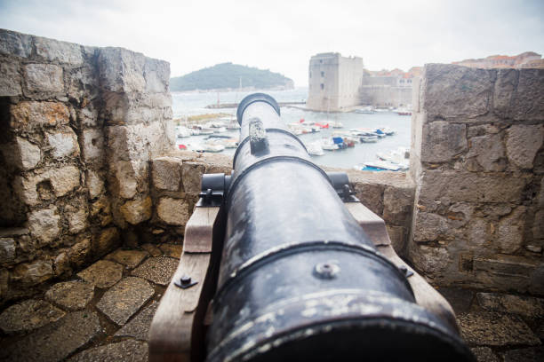 Dubrovnik and cannon on wall Dubrovnik and cannon on wall former yugoslavia stock pictures, royalty-free photos & images