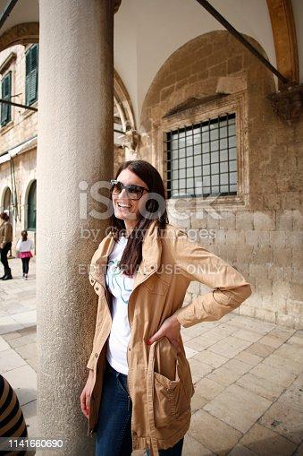 Dubrovnik, Croatia, April 4, 2013 : Young Beautiful Woman in Sunglasses on the Street