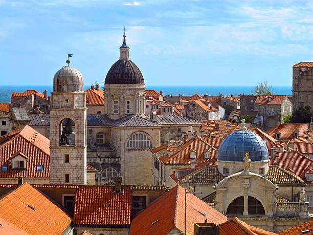 Dubrovnik Croatia skyline domed churches tiled roofs stock photo