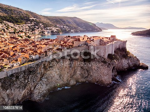 Dubrovnik old town city walls aerial view in a sunny day