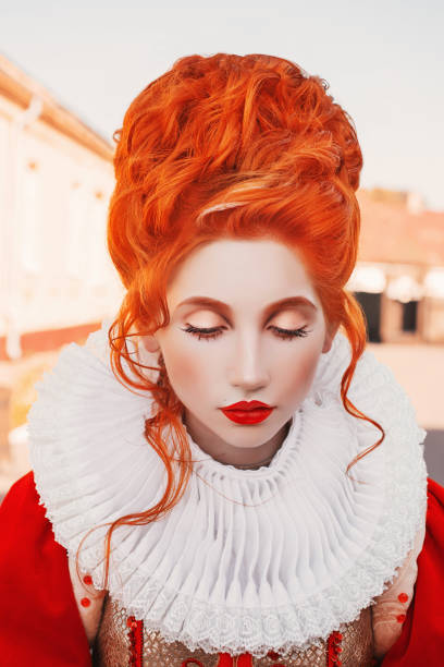 duchess look down. young baroque redhead queen portrait with historical hairstyle. renaissance princess with red hair. fairytale queen in red dress. baroque duchess. rococo hairdo. white collar - duchessa foto e immagini stock