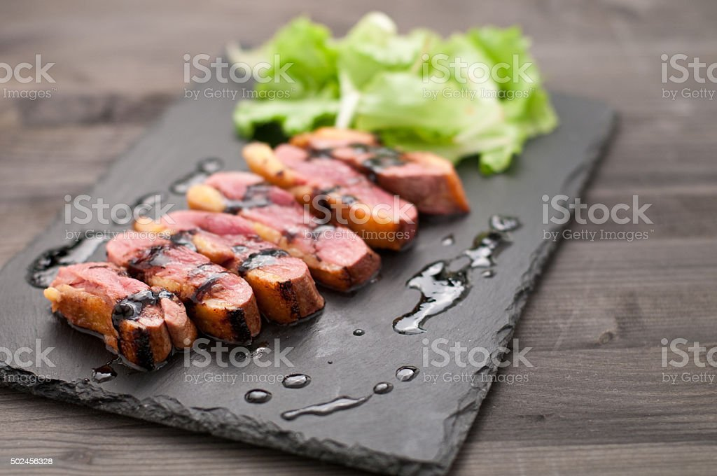 Duck breast baked with honey and balsamic vinegar stock photo