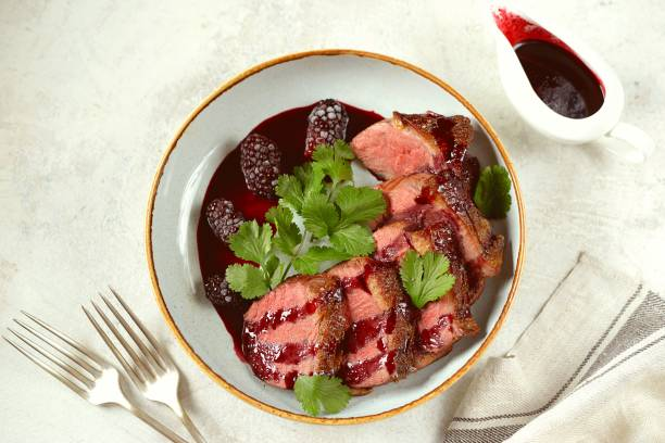 Duck breast in blackberry sauce. Homemade organic food. stock photo
