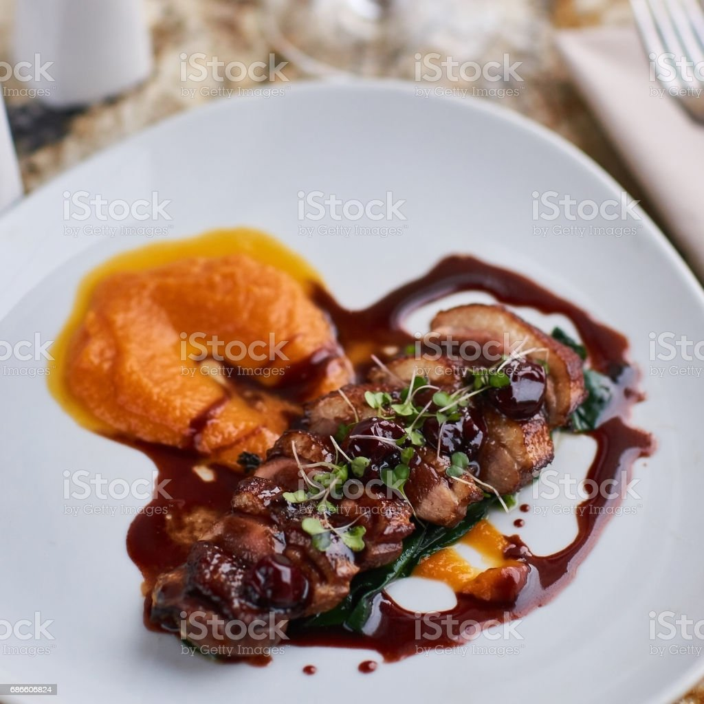 Duck breast Magret with mashed pumpkin royalty-free stock photo