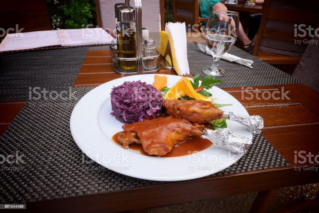 Duck Thigh On Red Cabbage Bed, Romania stock photo