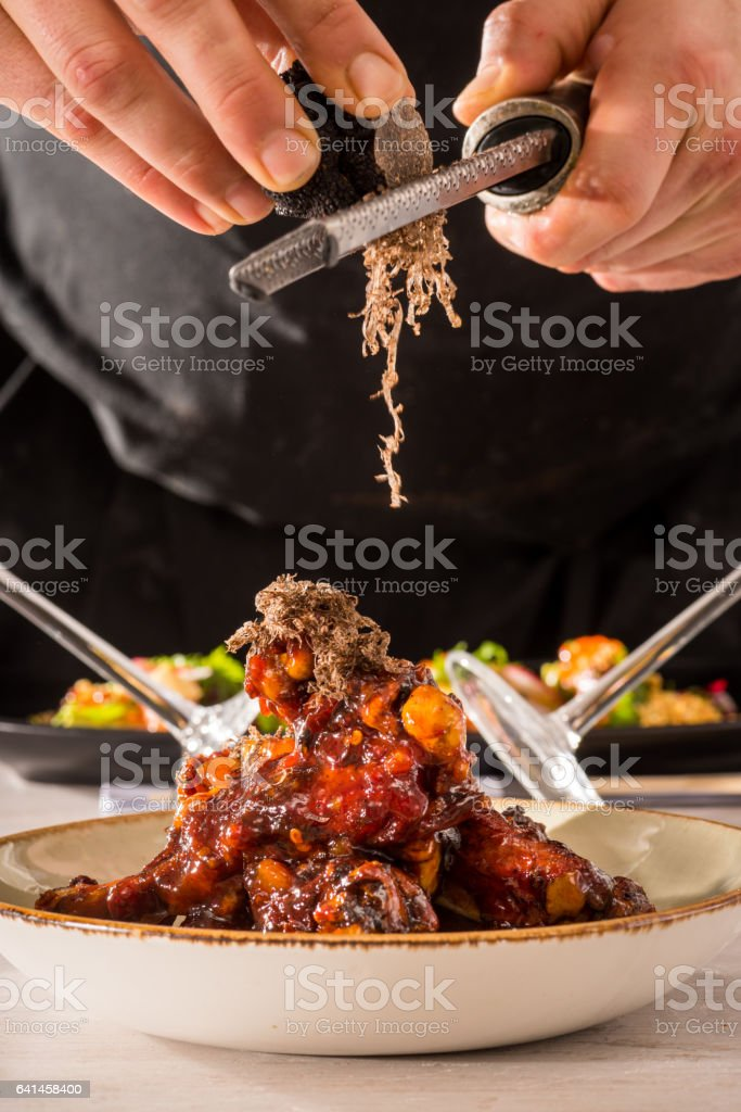 Duck wings and black truffle stock photo