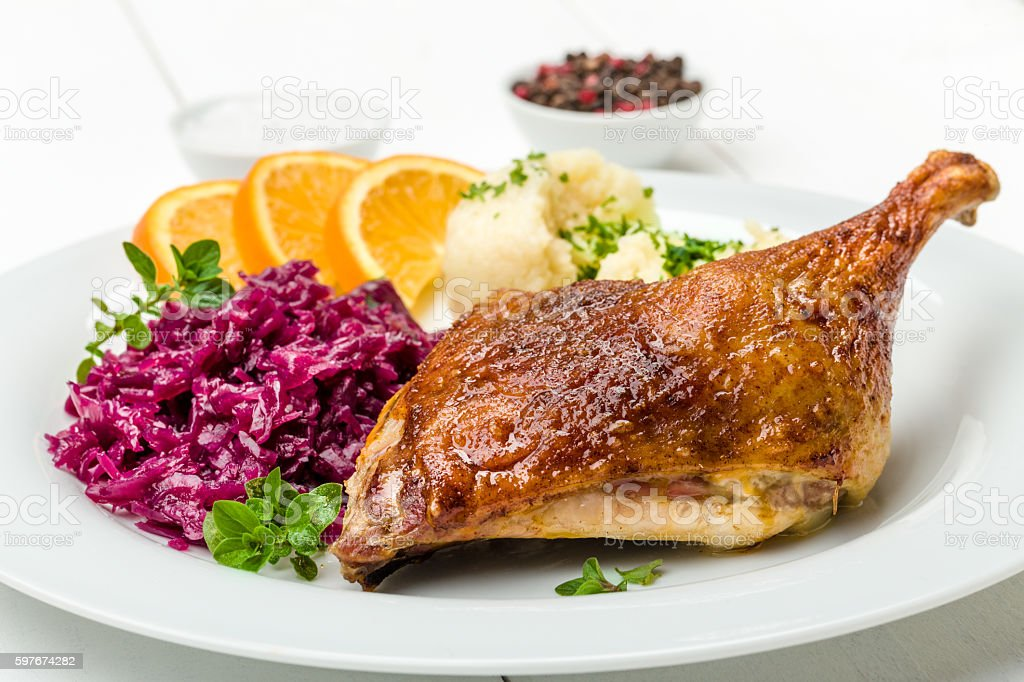 Duck with dumplings and red cabbage stock photo