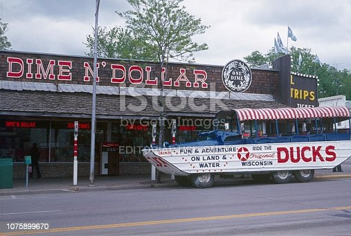 Dells, Wisconsin, 1977. Ducks Tours Military Vehicle. Furthermore: Store Advertising Sign.