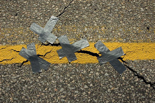 Duct tape fixes everything... including this storm ravaged road